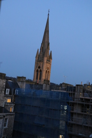 Gently chimed every 15 minutes. Thought it was the sunset gilding the spire, but it was floodlights.