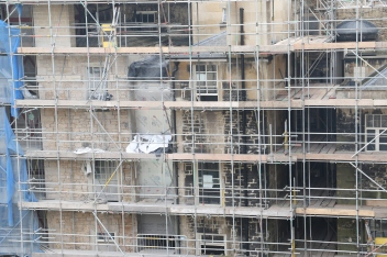 View from my window of the rest of the hotel complex. Getting the old stone cleaned up. Cleaned stone to the left, dirty to the right.